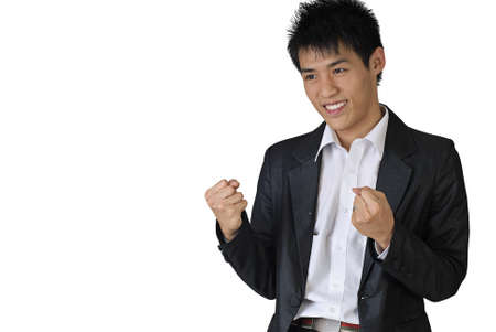 Excited young business man of Asian with copyspace on white. Stock Photo - 7135391