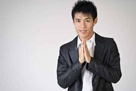 Thai greeting gesture by Asian young business man. photo