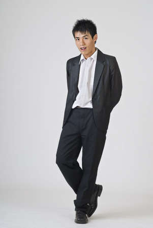 Full length portrait of young businessman standing. photo