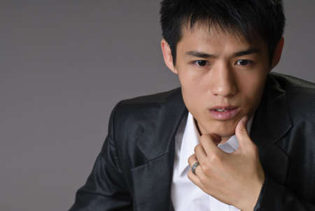 Asian business man closeup portrait, young, handsome and confident expression. photo