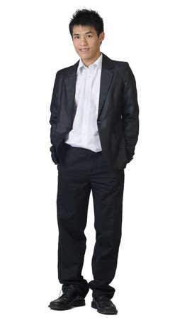 expresion corporal: Longitud total de hombre de negocios Asia joven pararse sobre fondo blanco.  Foto de archivo