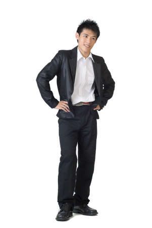 Smart businessman of Asian standing against white background. photo