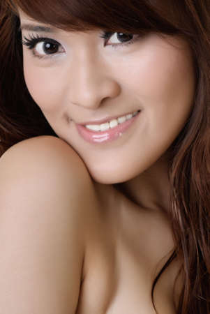 Closeup portrait of beauty of Asian with smiling expression. photo
