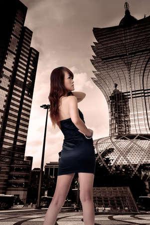 Cityscape of sexy woman in city with skyscraper. photo