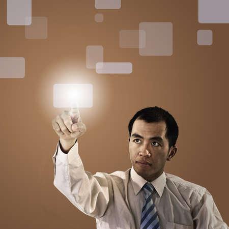 pressing: Business man pressing a touchscreen button.