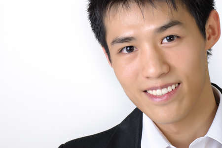 Closeup portrait of young business man of Asian with copyspace on white. photo