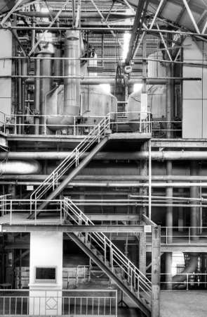 steel factory: Building interior structure of old factory in black and white. Stock Photo