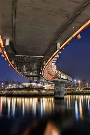 Bridge in night, colorful cityscape with modern architecture and buildings in evening. Stock Photo - 7304465