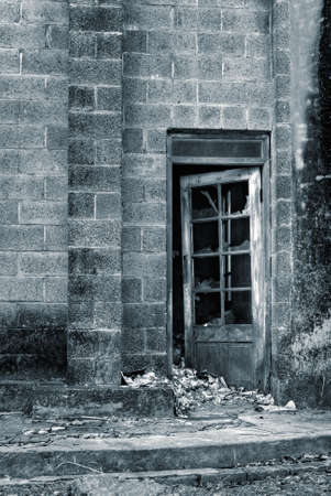 Ruin of old wall and windows and door. photo