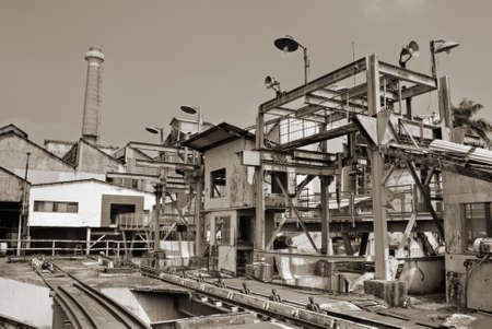 Architecture of industrial factory exterior with buildings and smokestack. photo