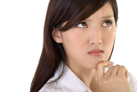 Worried business lady face, closeup portrait of oriental woman on white background. photo