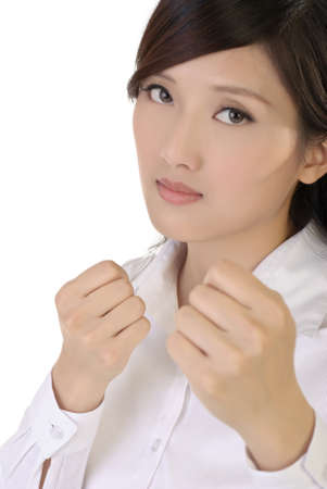Fighting pose of businesswoman, closeup portrait of oriental office lady on white background. photo