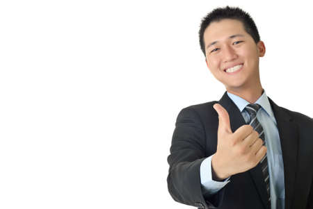 Smiling young businessman give you a excellent sin with copyspace on white. photo