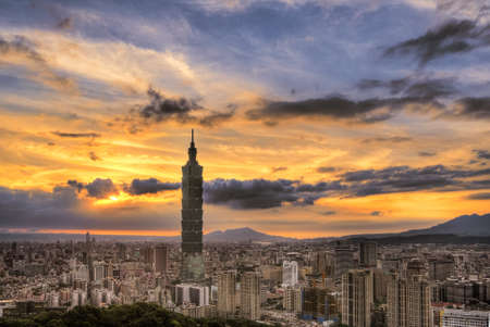 Taipei cityscape in sunset with dramatic sky and famous landmark, skyscraper in Taiwan.