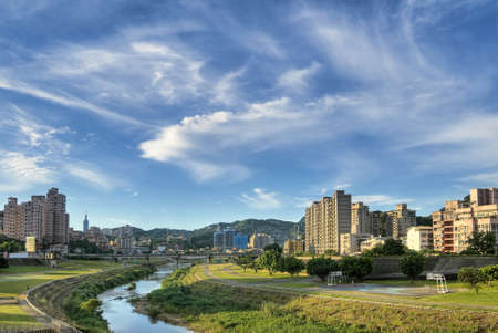 City scenery of park and river under blue sky and white clouds in Taipei, Taiwan. Stock Photo - 7417640