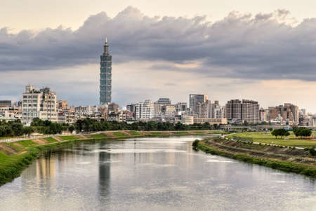 Cityscape of river with famous landmark, the 101 skyscraper, and reflection in Taipei, Taiwan.