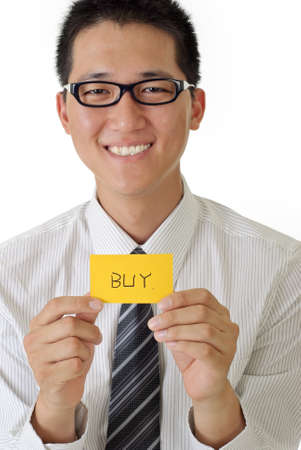 Shopping business man holding card written buy words and smiling. photo