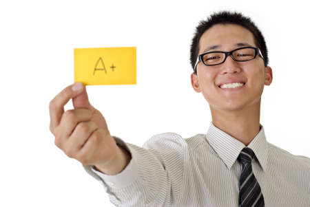 Happy business man holding A+ yellow card and smiling, closeup portrait focus on face against white background. photo