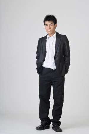 Immature young businessman, full length portrait of Asian office man. photo