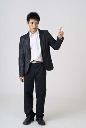 Young business man point, full length portrait of Asian. photo