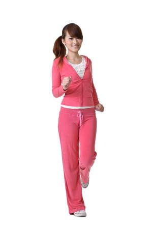 girl jogging: Jogging girl with joy, full length portrait isolated on white background.