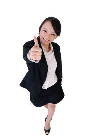 Happy smiling business woman give you a excellent sin, full length portrait isolated on white background. photo