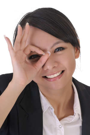 Cute office lady with funny face by put hands on one eye, closeup portrait on white background. photo