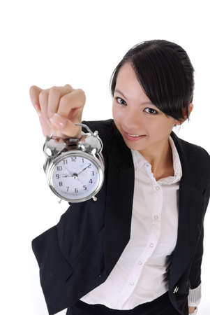woman clock: Happy smiling business girl holding alarm clock on white background, closeup portrait.