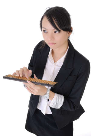 Chinese business girl use abacus and think, closeup portrait on white background. photo