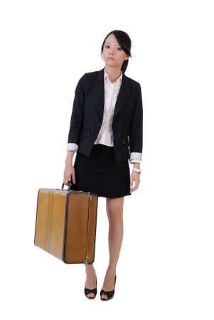 Single business girl holding old traveling case with lonely expression, full length portrait isolated on white background. Stock Photo - 7595937