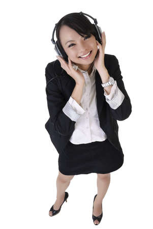 Happy smiling business woman listen music by headphone, full length portrait isolated on white background. photo