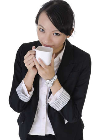 Business woman grin with joy and hold cup of coffee, closeup portrait on white background. photo