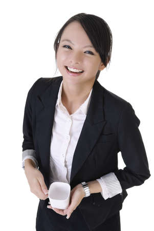 Happy smiling business woman with cup of drink, closeup portrait on white background. photo