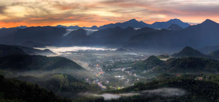 Village in mountain, morning scenery with dramatic sunrise and fog in forest, Taiwan, Asia. photo