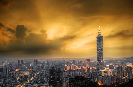City skyline with dramatic sky and famous skyscraper and buildings in Taipei, Taiwan.