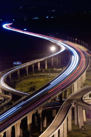 fast lane: City traffic with high way in night in Taiwan, Asia.