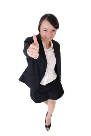 look pleased: Happy smiling business woman give you excellent sing, full length portrait isolated on white background.