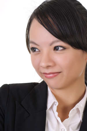 Shy business woman with smile, closeup portrait on white background. photo