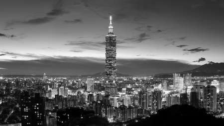 City skyline in Taipei with famous landmark 101 skyscraper and buildings in night in Taiwan.