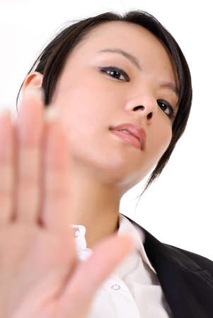 unfriendly: Cool business woman with reject gesture, closeup portrait of Asian lady. Stock Photo