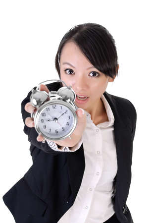 Late to office concept, closeup portrait of business woman holding alarm clock on white background. photo