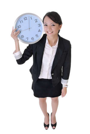 Happy business woman holding clock on shoulder with joy, full length portrait isolated on white background. photo