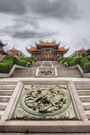 Chinese temple with dragon carving decorated on stone stair. photo