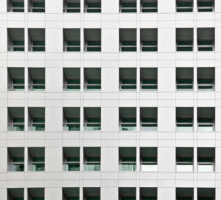 Office building exterior with windows, architecture scenery in day. photo