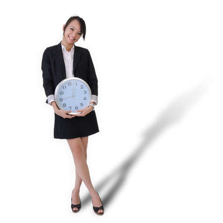 Happy smiling business woman with clock, time concept with full length portrait isolated on white background. Stock Photo - 7702379