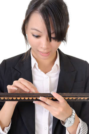 Chinese business woman with excitation using abacus against white background. photo