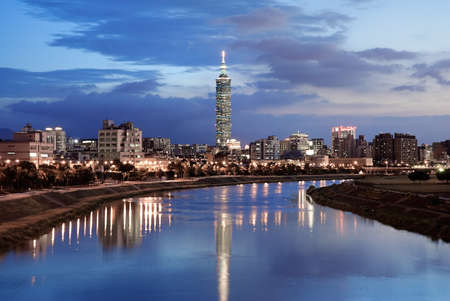 Serenity cityscape with skyscraper and river in night in Taipei, Taiwan.