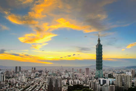 City skyline with dramatic clouds and famous skyscraper in Taipei, Taiwan.