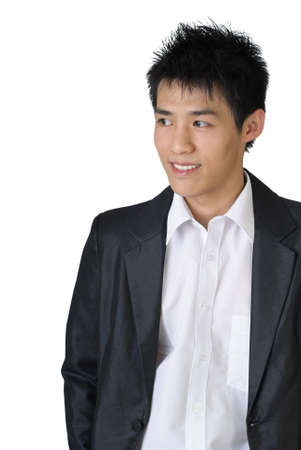 Portrait of young businessman of Asian against white background.