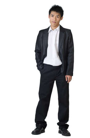 Full body portrait of Asian young businessman standing against white background. photo